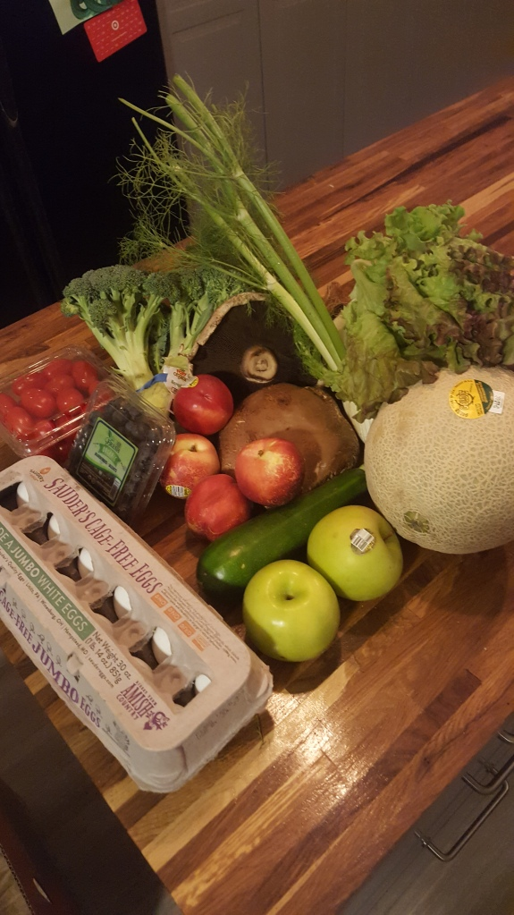 Cherry tomatoes, blueberries, white nectarines, green apples, cantaloupe, broccoli, two portabella mushroom caps, a small fennel bulbs, a zucchini and a head of red lead lettuce.