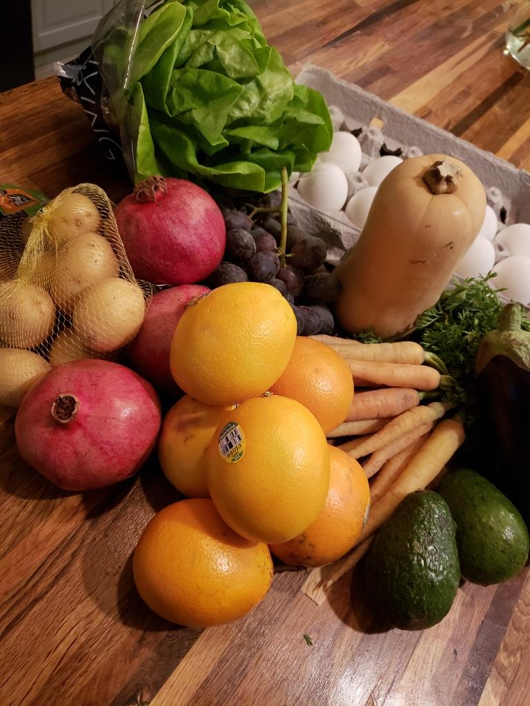 Yellow potatoes, pomegranates, green leaf lettuce, red grapes, butternut squash, eggplant, skinny carrots, avocado and oranges, plus jumbo eggs (add-on).